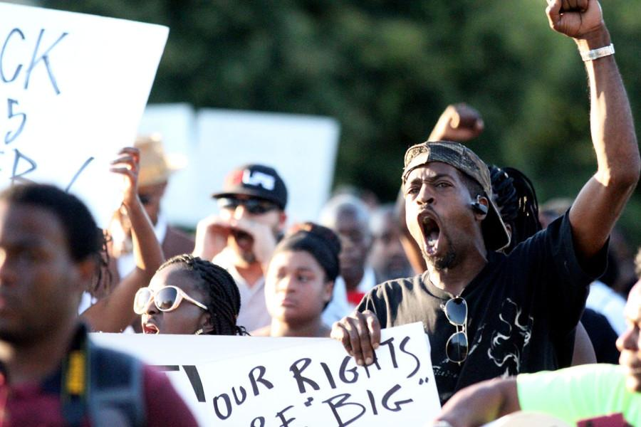 While+chanting+and+holding+signs%2C+protesters+marched+through+the+streets+of+McKinney.
