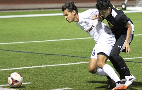 At the Denison game junior Pedro Sanchez defends the ball. The lions won 4-0.