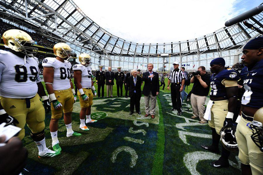 120901-N-LD296-004  DUBLIN (Sept. 1, 2012) U.S. Ambassador to Ireland, the Honorable Daniel Rooney (center left) and Irish Prime Minister Enda Kenny take part in the opening coin toss during the NCAA Emerald Isle Classic college football season opener in Aviva Stadium. Notre Dame played Navy for the 86th straight year, making it the longest continuous intersectional rivalry in the U.S. (U.S. Navy photo by Senior Chief Mass Communication Specialist Michael Lewis/Released)