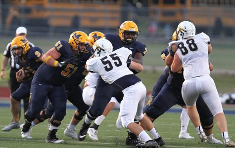 The Pancake Platoon protects running back Matt Gadek against Keller's defense.