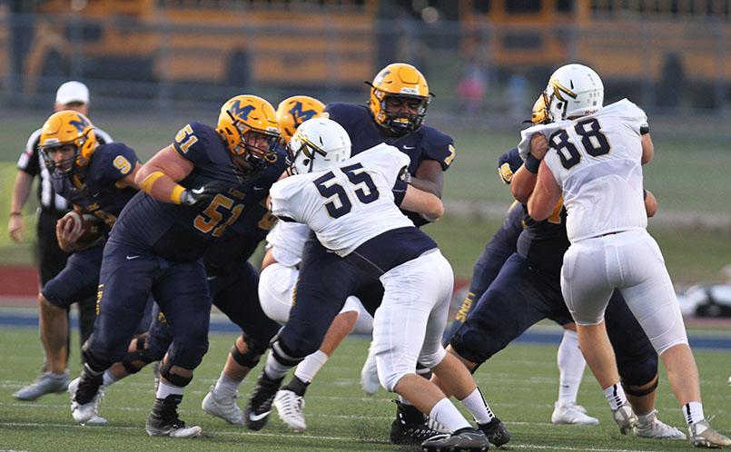 The Pancake Platoon protects running back Matt Gadek against Keller's defense.