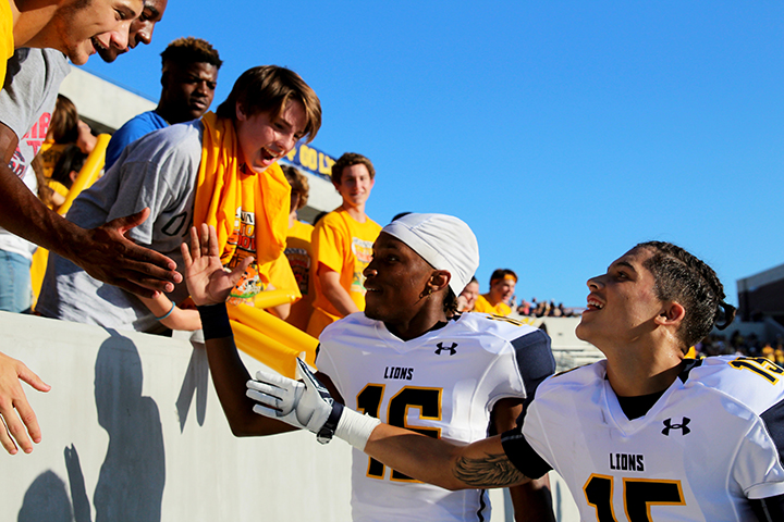 Aaron Brown and Isaiah Rojas talk to their friends before the start of the game.