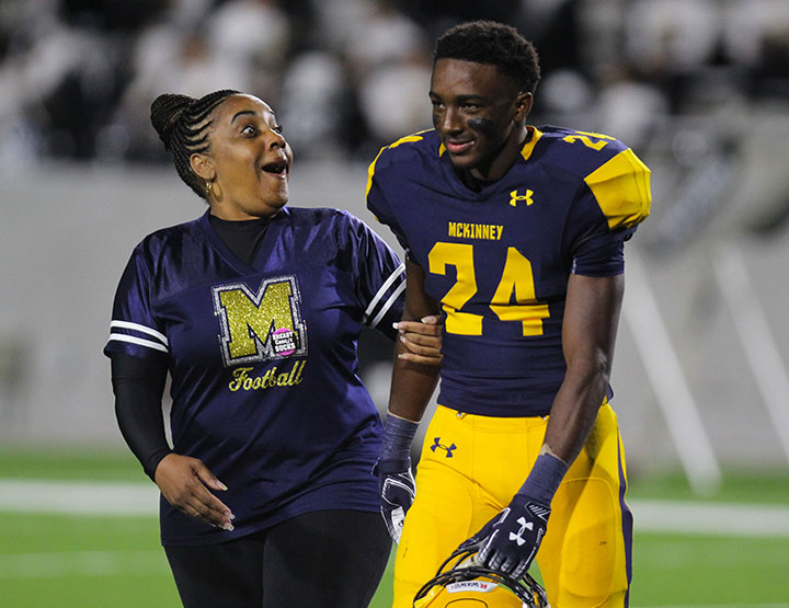 Senior Andrew Pitts reacts with his mom to the announcement that he had won Homecoming King.