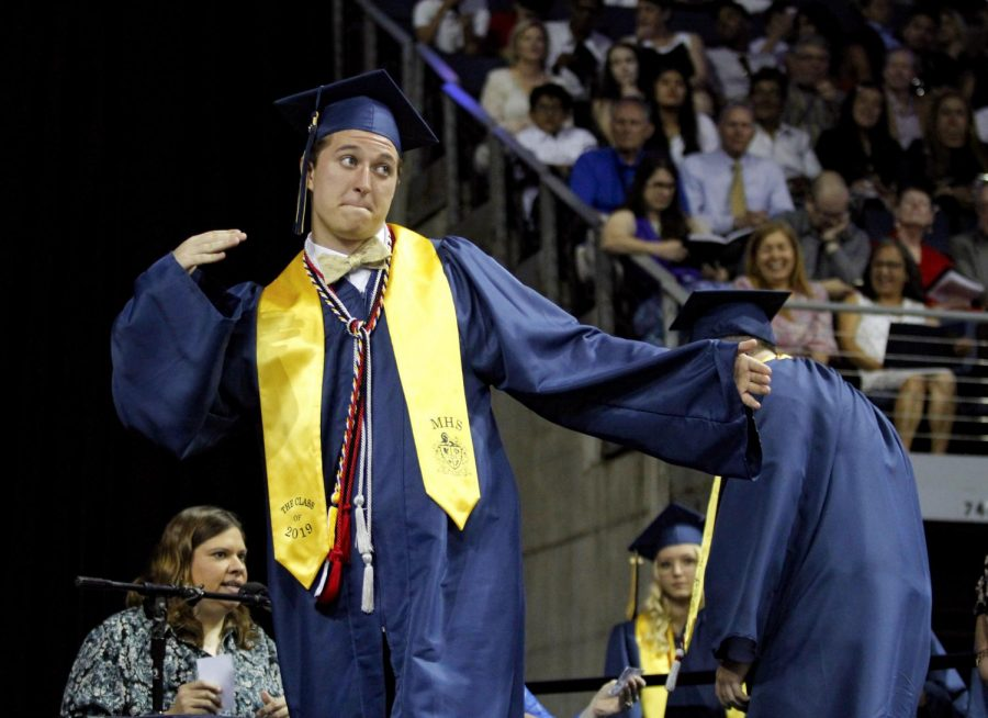 Bryce Worley celebrates before receiving his diploma.