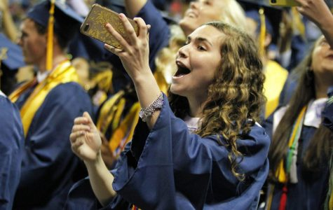 Hannah Freeman records throwing her cap into the air along with the rest of her graduating class.
