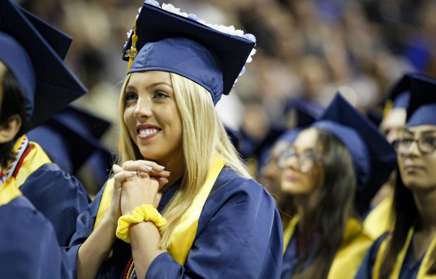 Caroline Swan is brought joy during Jacob Harsch's valedictorian speech.