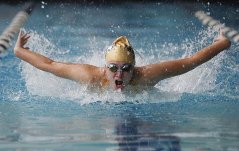 Kaylee Lewis swims butterfly in the first meet of the season against Denison, McKinney North, and Boyd.