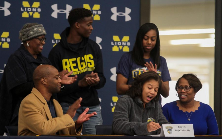 Erin Fry signs to Regis University for basketball.