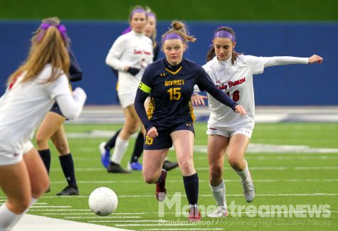 Estelle Flanagan attacks down the line  in the game against McKinney Boyd.