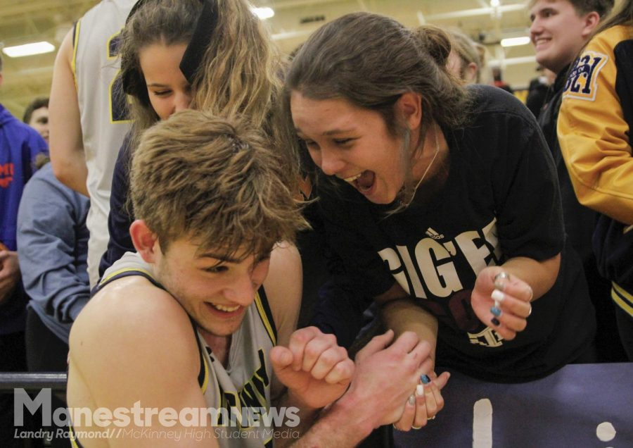After Lions winning the boys basketball game against crosstown rivals, McKinney Boyd High School, Lexy Quirrenbach congratulates her friend, Blaise Roney.