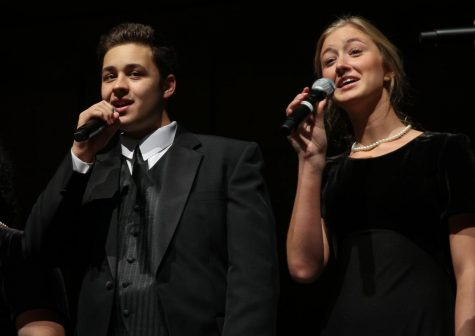 Senior Andrew Holmes and junior Lexi Short perform at the choir fall concert.