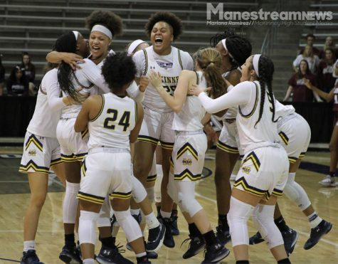 The basketball team celebrates after winning against Plano Senior 32-28, earning themselves a spot in the state tournament.