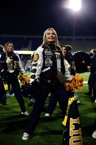 Senior Mia Cassidy cheers on the sidelines of the last football game of the year vs. Little Elm.