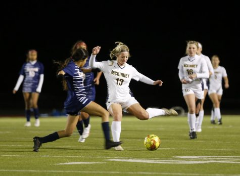 During the soccer game against Sachse High School, senior Madison Lane passes the ball to a fellow teammate.